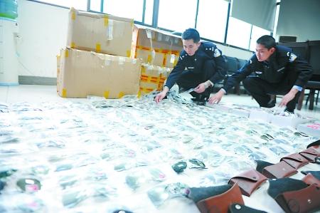 """唐静/原标题:千元""""雷朋""""太阳镜为啥这家网店一副只卖40元?昨日,..."""