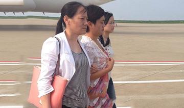 浙江跑路女老板被押解回国全程