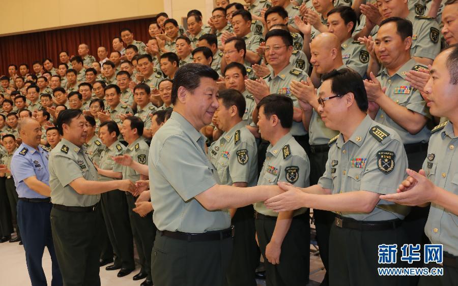 中央军委向军区部队官兵致以诚挚的问候,并向全军指战员、武警部图片