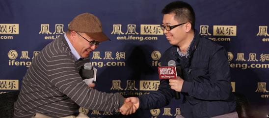卢米埃影城总裁胡其鸣与猫眼运营总监康利握手言欢