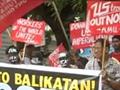 """实拍菲律宾民众游行 要求美军""""滚出去"""""""