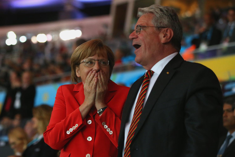 2014年7月14日,巴西马拉卡纳球场,2014巴西世界杯决赛,德国加时1比0绝杀阿根廷。图为进球瞬间的德国总理默克尔。