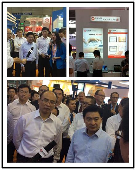 图1、深圳市委书记王荣,市长许勤参观信融财富公司展台