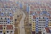 2014年1月7日,山东乳山,拥有60栋楼的水岸人家小区,冬季来临的时候只剩下不足40户人家,入住率不足3%。 (实习编辑:容少晖)