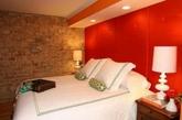 色彩。深橘色的墙面能让卧室变得性感撩人。(实习编辑:温存)