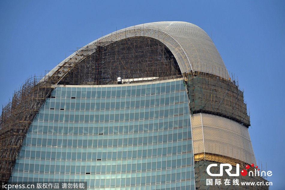的效果.图为2013年10月30日,正在建设中的人民日报新大楼.