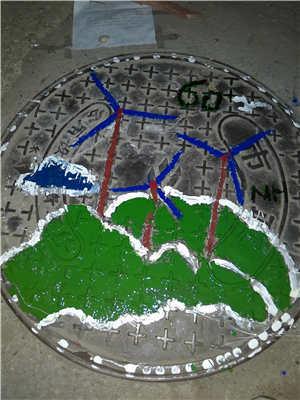 """湖南一高校涂鸦环保主题井盖倡议""""地球1小时"""""""