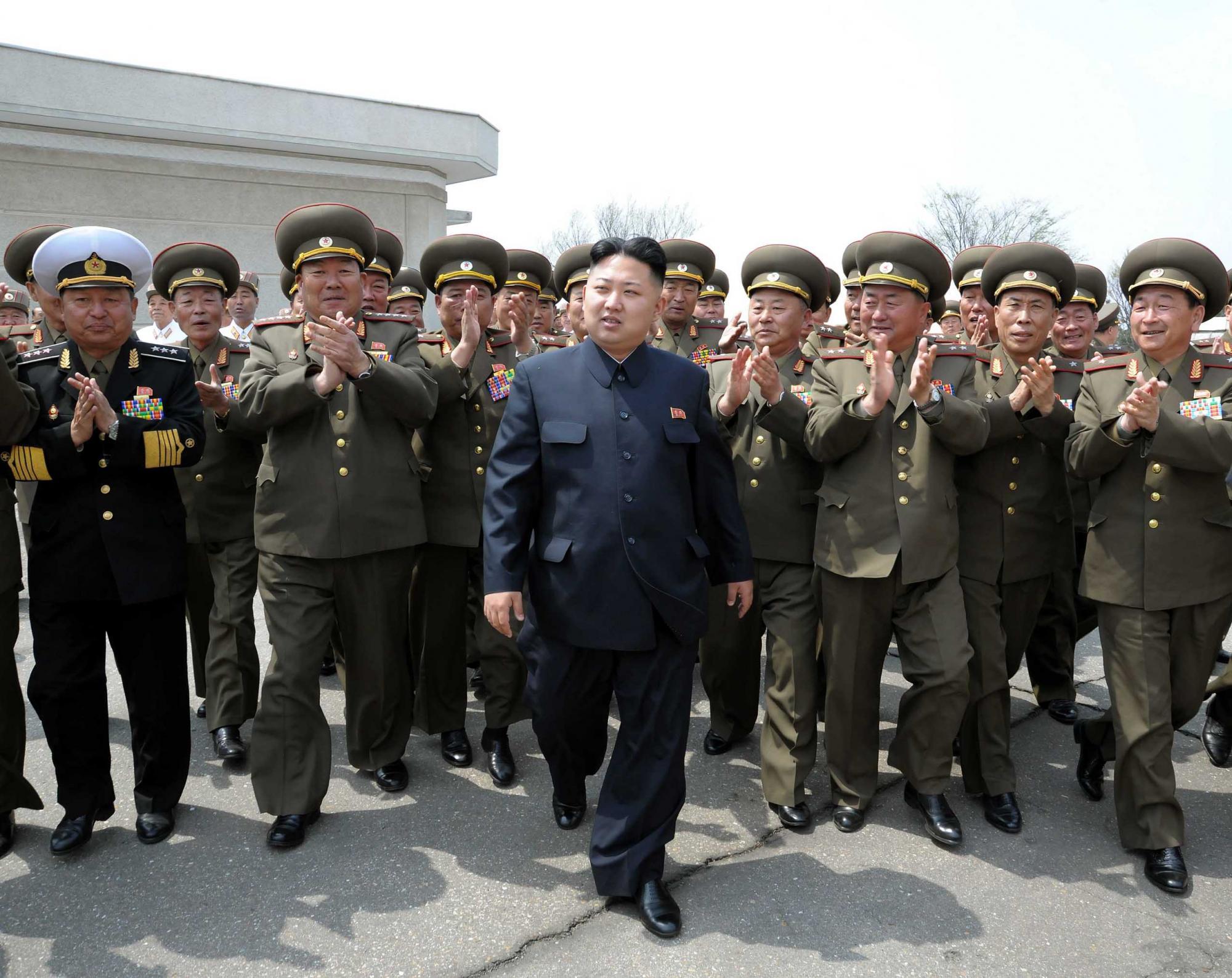朝鲜总统金正恩图片 朝鲜总统金正恩座驾 朝鲜总统金正恩简历