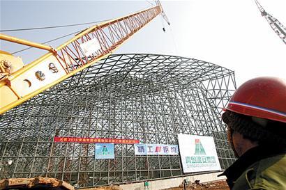世园会植物馆主体封顶 1.4万根钢结构杆件拼成